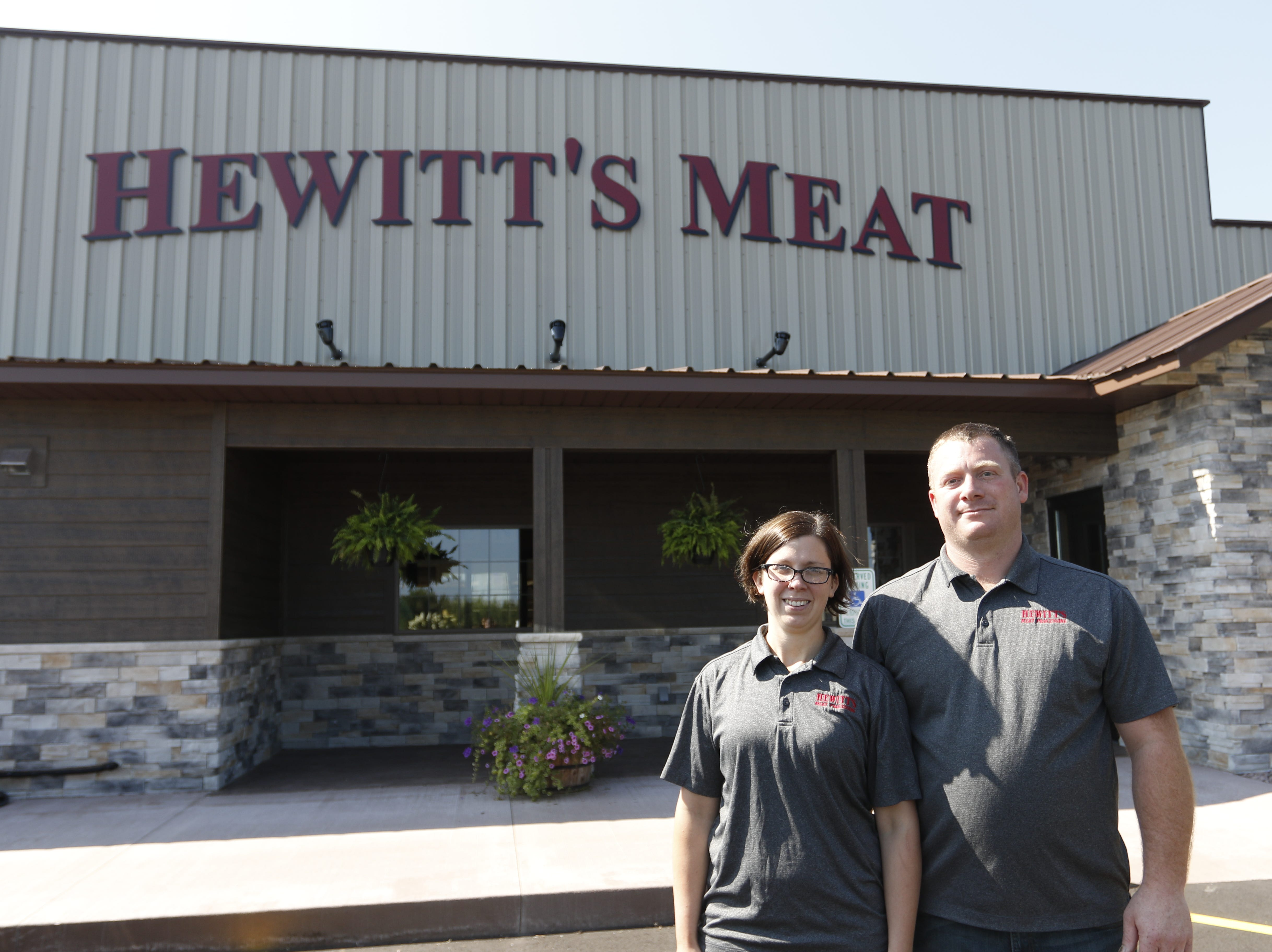 Owners Amanda and John Franseen stand in front of the new location of Hewitt's Meat, 210 Downwind Drive, Marshfield Tuesday, July 31, 2018.