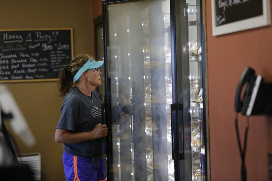 Caroline Wunrow of Richfield shops at the new location of Hewitt's Meat, 210 Downwind Drive, Marshfield Tuesday, July 31, 2018.