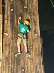 Grayson Jones on the rock climbing wall.