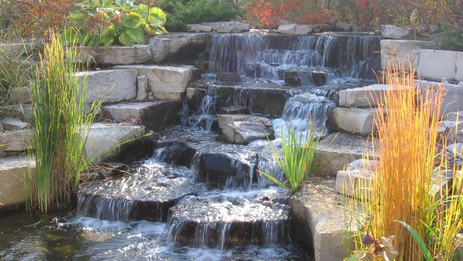 Landscaped ponds, waterfalls add a soothing oasis to your ...