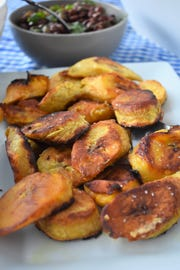 Ripe plantains are sliced on the diagonal and then fried in this simple preparation.