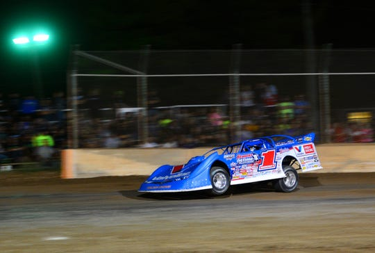 Brandon Sheppard drives into Turn 3 while leading he feature during the World of Outlaws Late Model Series program Monday, July 31, 2018, at the Plymouth Dirt Track at the Sheboygan County Fairgrounds in Plymouth, Wis.