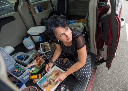 DaNeal Eberly, a receptionist at the Alabama Board of Cosmetology, paints in her van on her lunch break Tuesday, July 31, 2018, in Montgomery, Ala.