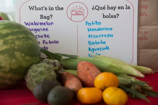A whiteboard lists the healthy produce received in the grocery bags distributed by Brighter Bites, hosted by the Boys & Girls Club of Collier in Immokalee on Wednesday, July 25, 2018.