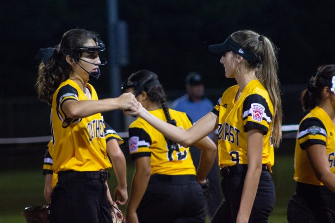 Melanie Almanza, left, and Audrey Mills celebrate after Southeast -- The District 9 Senior Little League softball team -- beat Canada 6-4 in its first game of the 2018 Little League World Series on Monday night in Roxana, Delaware.
