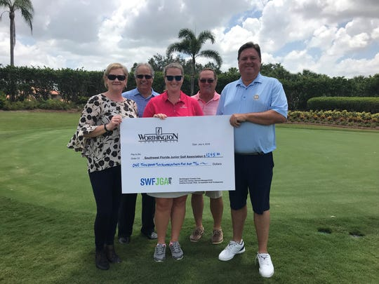 """On Thursday, July 19, Worthington Country Club's Mike Danieli (president), Jim Bartelo (vice president), Carol Ann Carney (general manager) and Kristine Connell (first assistant professional) presented a check for $1,245 to Jeff Nixon, the president of the Southwest Florida Junior Golf Association. Funds were raised during the recent Fourthof July """"Beat the Pros"""" event."""
