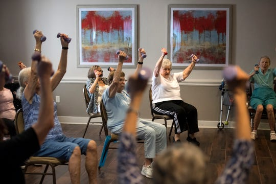 (center - wearing a white shirt) Helen Haupt during an exercise class at Arbor Terrace in Teaneck on Tuesday, July 31, 2018.