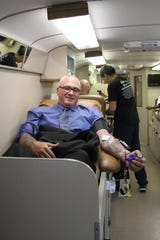 Carlsbad POlice Department Chief Shane Skinner donated blood during the annual Battle of the Badges Blood Drive in Carlsbad July 31.