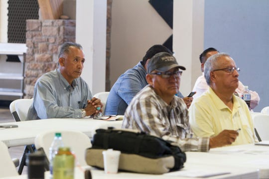 San Juan Chapter President Rick Nez, left, participates in a workshop Tuesday at the Nenahnezad Chapter house.