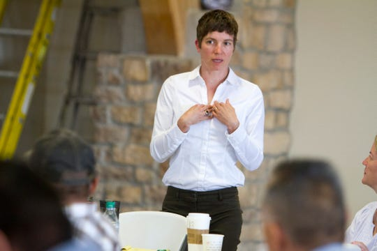 Karin Wadsack, project director for Northern Arizona University School of Earth Sciences and Environmental Sustainability, addresses the crowd Tuesday during a workshop at the Nenahnezad Chapter house.