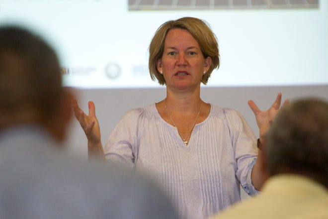 Kris Mayes, a professor at Arizona State University, addresses the crowd Tuesday during a workshop at the Nenahnezad Chapter house on solar power developments.