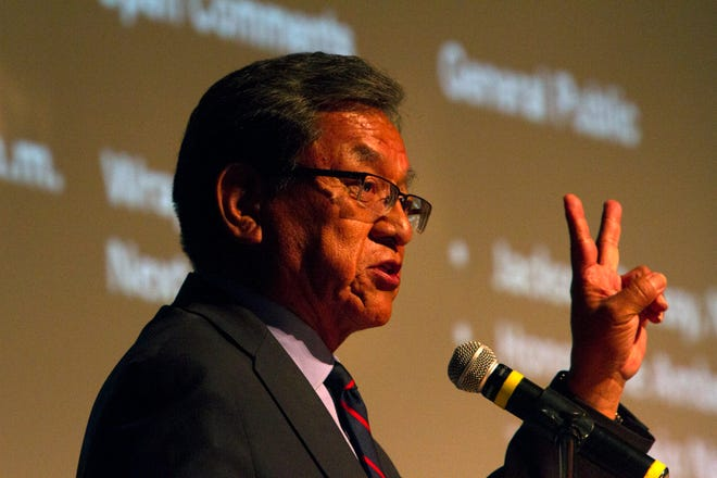 Navajo Nation President Russell Begaye addresses the crowd Tuesday during a Radiation Exposure Compensation Act public meeting at the Phil L. Thomas Performing Arts Center in Shiprock.