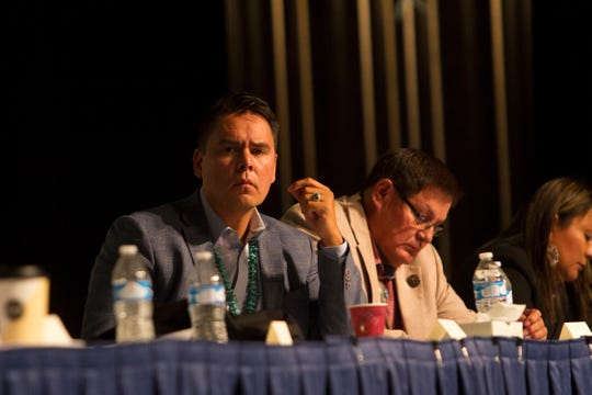 Jackson Brossy, executive director of the Navajo Nation's Washington office, left, and Navajo Nation Council Speaker LoRenzo Bates listen during a Radiation Exposure Compensation Act update public meeting Tuesday at the at the Phil L. Thomas Performing Arts Center in Shiprock.