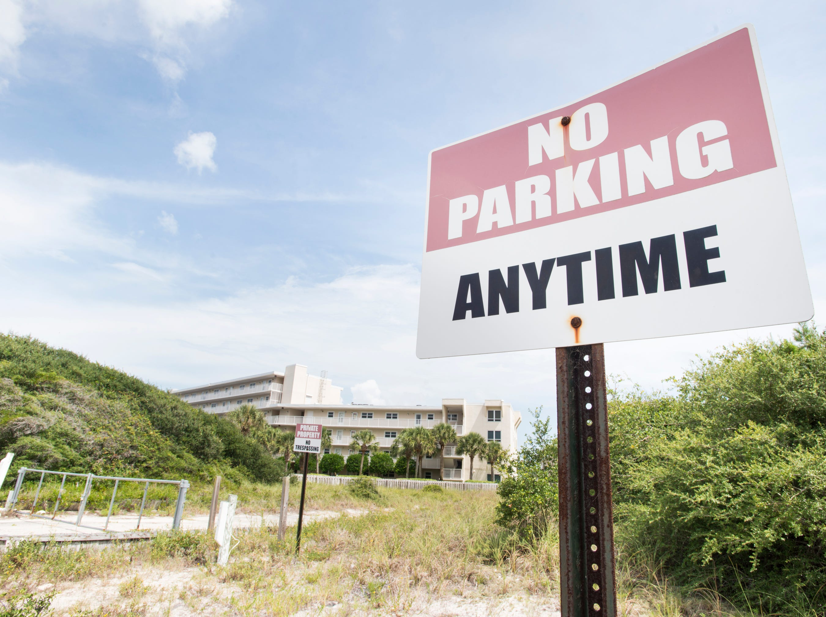 "Beachfront property owned by Escambia County is marked ""No Parking Anytime"" and ""Private Property - No Trespassing"" in Perdido Key on Tuesday, July 31, 2018.  The county owned property currently sits vacant with no public parking and no public access to the beach."