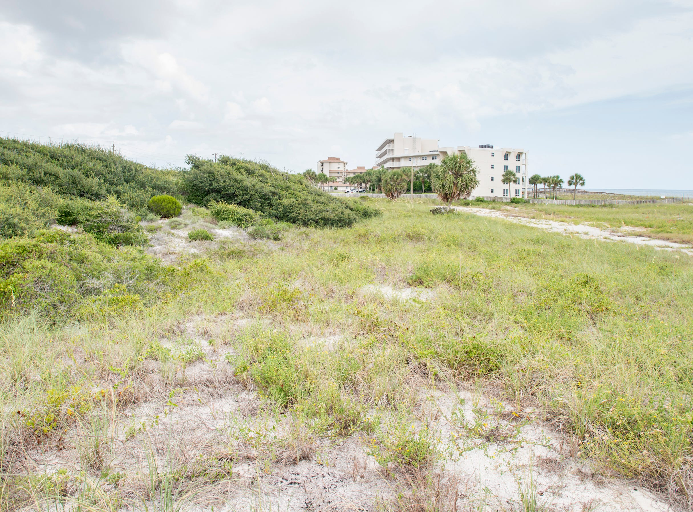 Beachfront property owned by Escambia County in Perdido Key on Tuesday, July 31, 2018.  The county owned property currently sits vacant with no public parking and no public access to the beach.