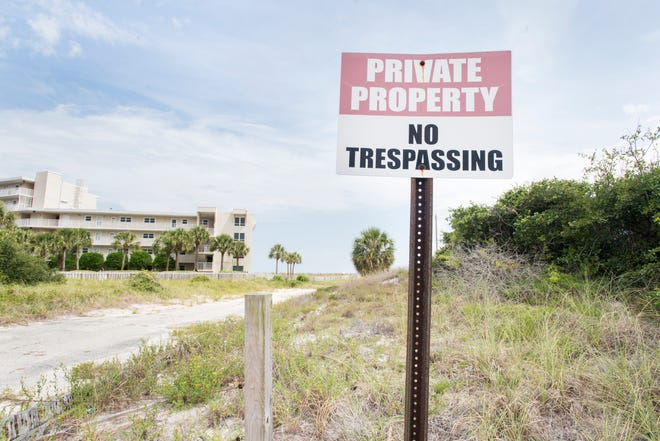 "Perdido Key beachfront property owned by Escambia County is marked ""Private Property — No Trespassing."""