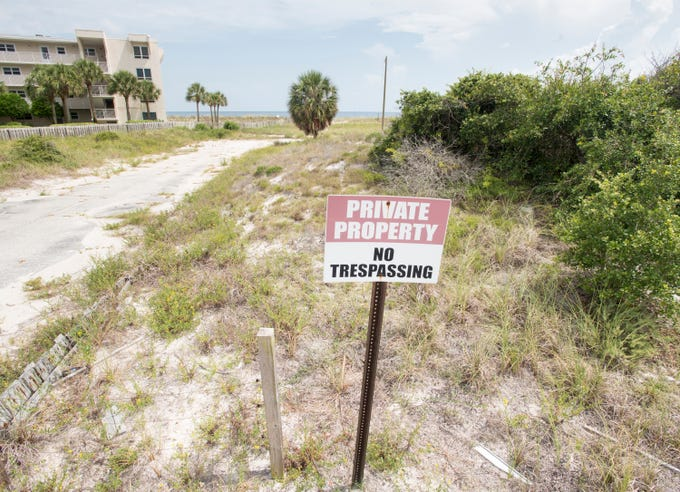 "Beachfront property owned by Escambia County is marked ""Private Property - No Trespassing"" in Perdido Key on Tuesday, July 31, 2018.  The county owned property currently sits vacant with no public parking and no public access to the beach."