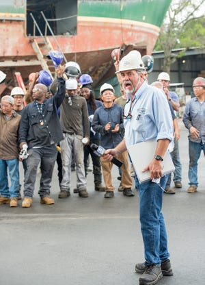Workers cheer as Frank Patti Jr., president of Patti Marine Enterprises, announces a $449,231 grant from the U.S. Department of Transportation's Maritime Administration during a press conference Tuesday at the Patti Shipyard in Pensacola.
