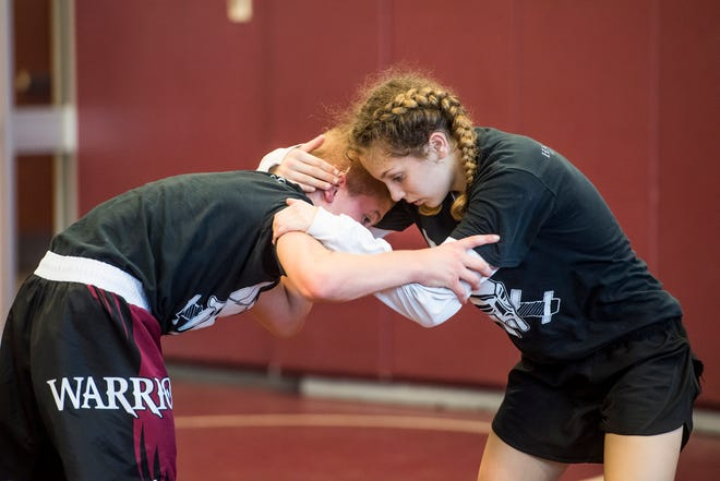 Montana DeLawder practices with her drill partner, Jacob Fetrow, during a team practice at Gettysburg Area High School on Thursday, July 26, 2018. DeLawder has strength and conditioning training four to five times a week during the summer and practices five times a week during the school year.
