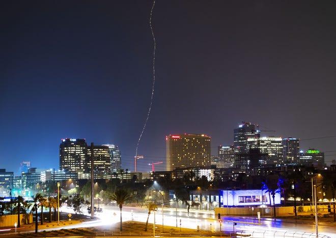 Lightning strikes a construction craner in downtown Phoenix, Ariz. July 30, 2018.