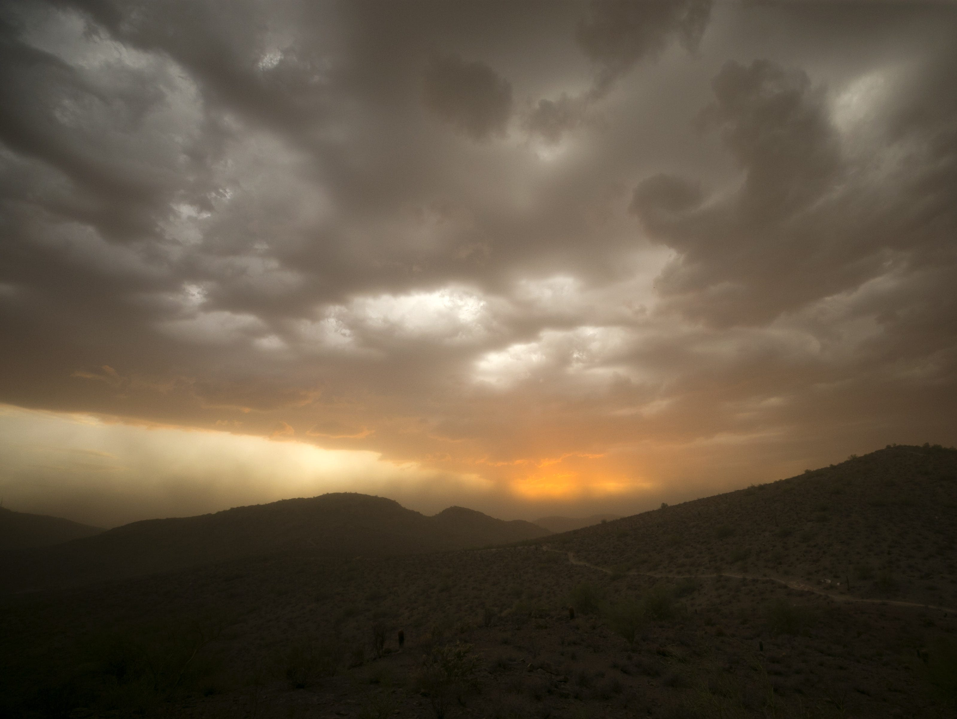Dust moves into North Mountain Park in Phoenix as the sun sets on Monday, July 30, 2018.