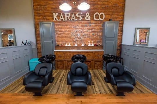 Hair-washing stations inside Karas & Co. salon in Port Huron.