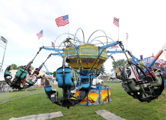 The Tornado spins fairgoers during the Ulster County Fair in New Paltz on July 31, 2018.