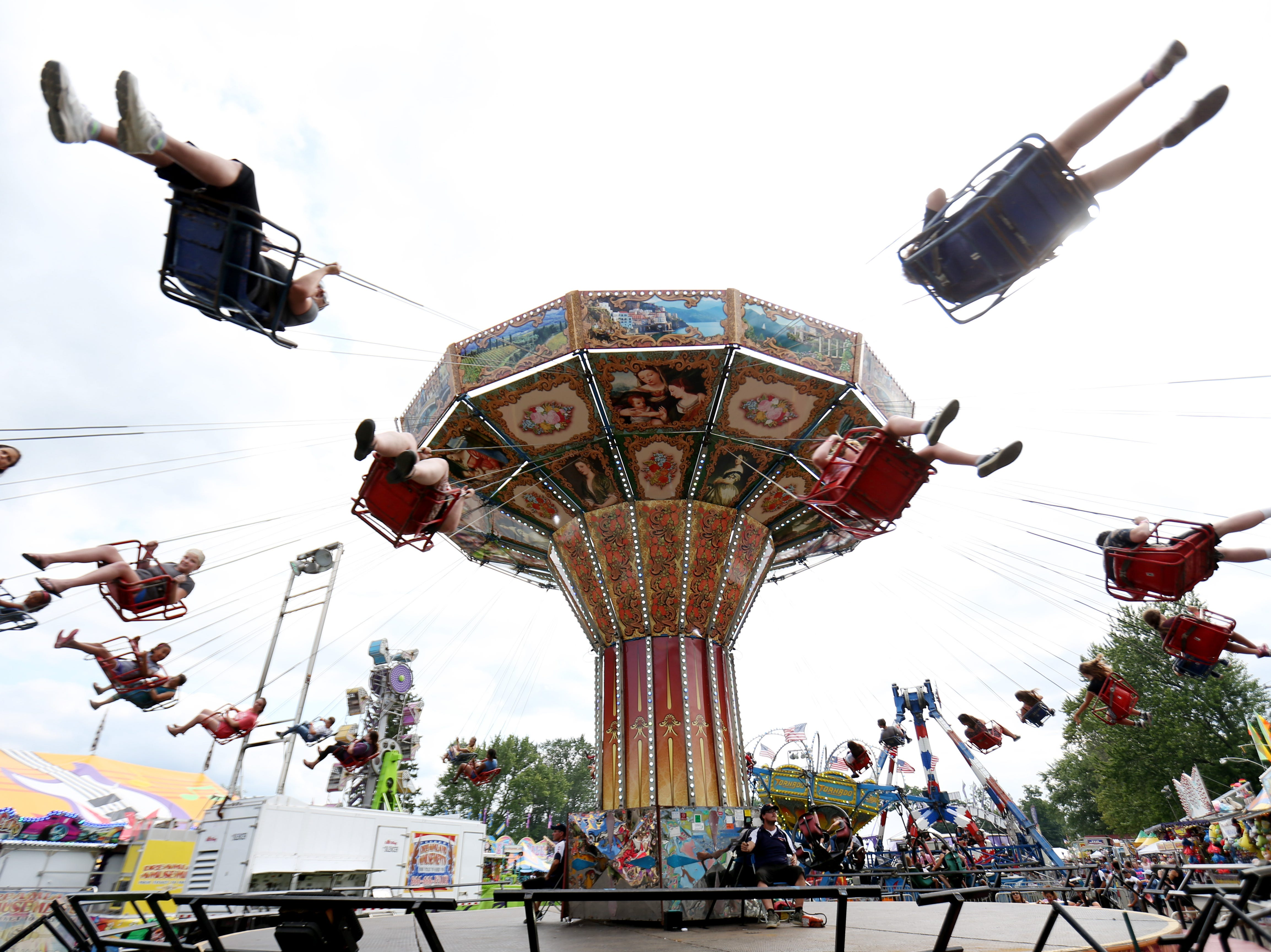 The swings carry riders during the Ulster County Fair in New Paltz on July 31, 2018.