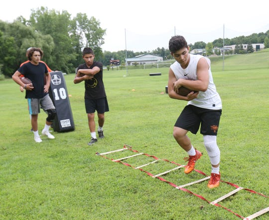 Alex Alcera works on his agility during a football workout session at Pawling High School on July 30, 2018. Pawling is switching to an 8 man format for the 2018 football season.