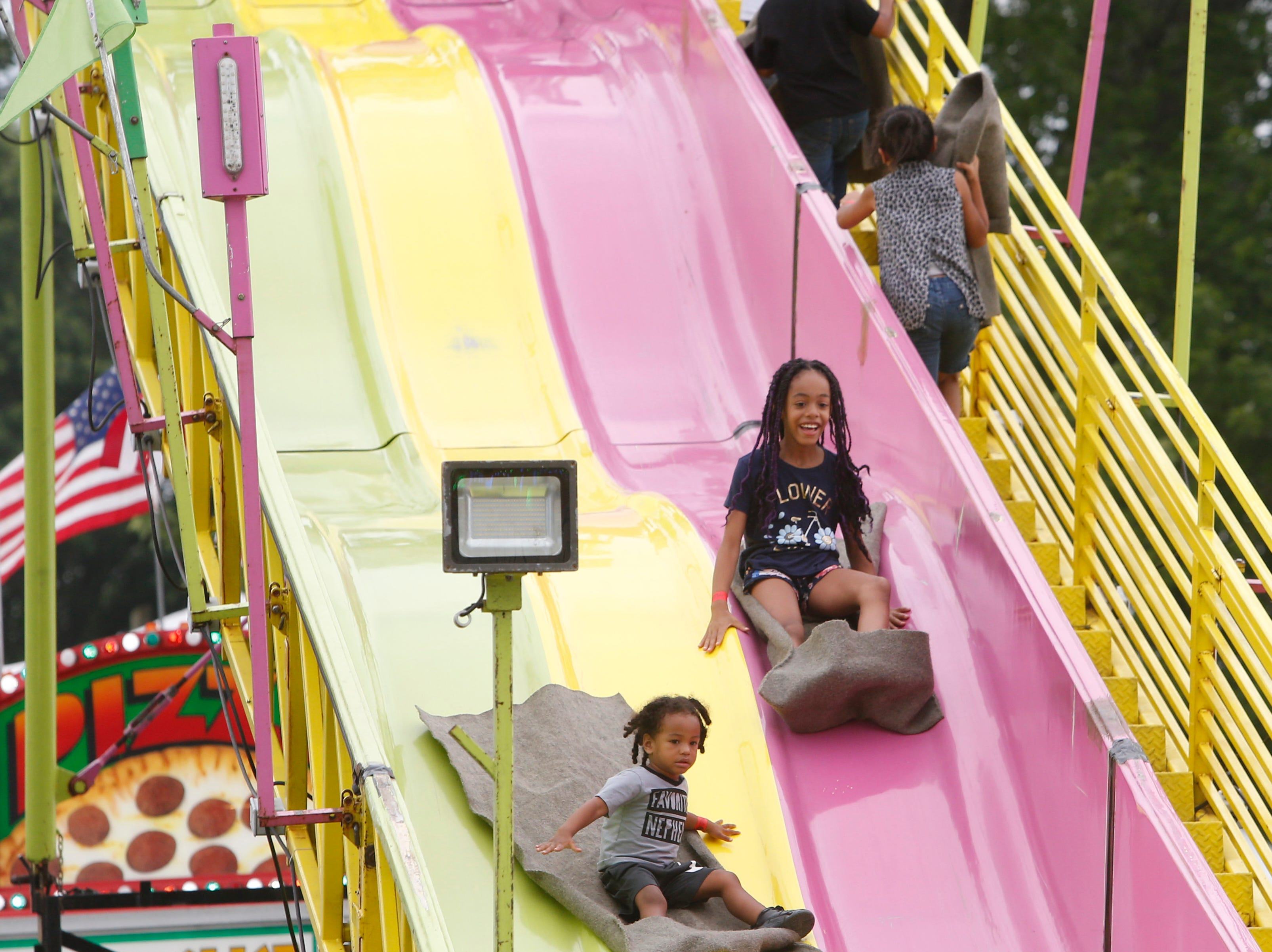 Children ride the slide at the Ulster County Fair in New Paltz on July 31, 2018.