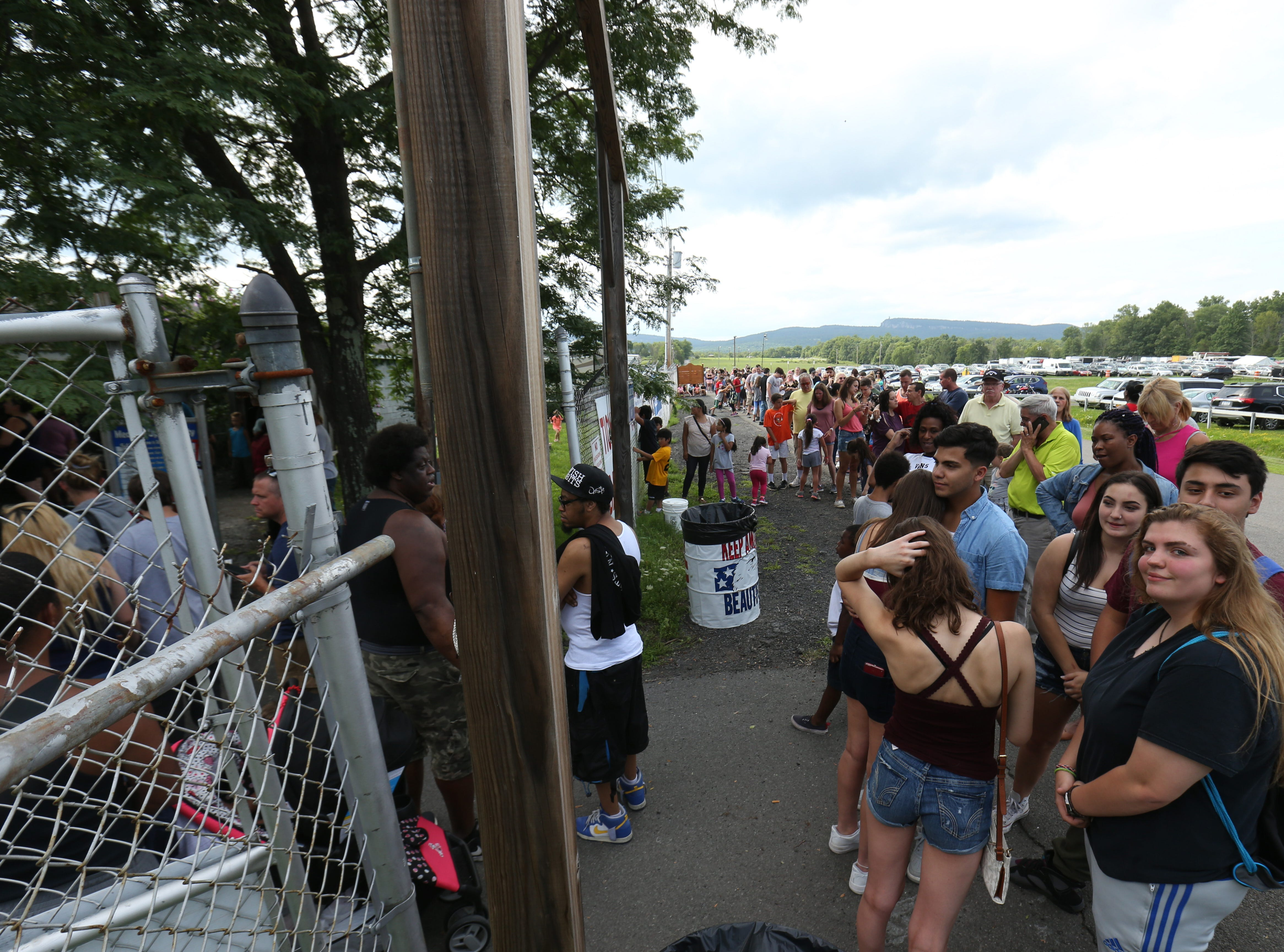 A crowd lines up outside the ticket booth at the Ulster County Fair for opening day in New Paltz on July 31, 2018.