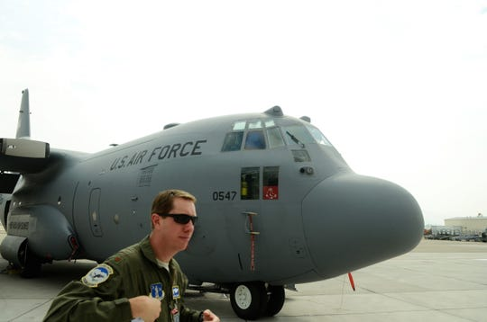Major Joseph Janquist of the Nevada Air National Guard 152nd Airlift Wing stands in front of a C-130 at the Reno-Tahoe International Airport. Janquist will be piloting a specially-equipped firefighting C-130 during air attack operations on the Northern California wildfires.