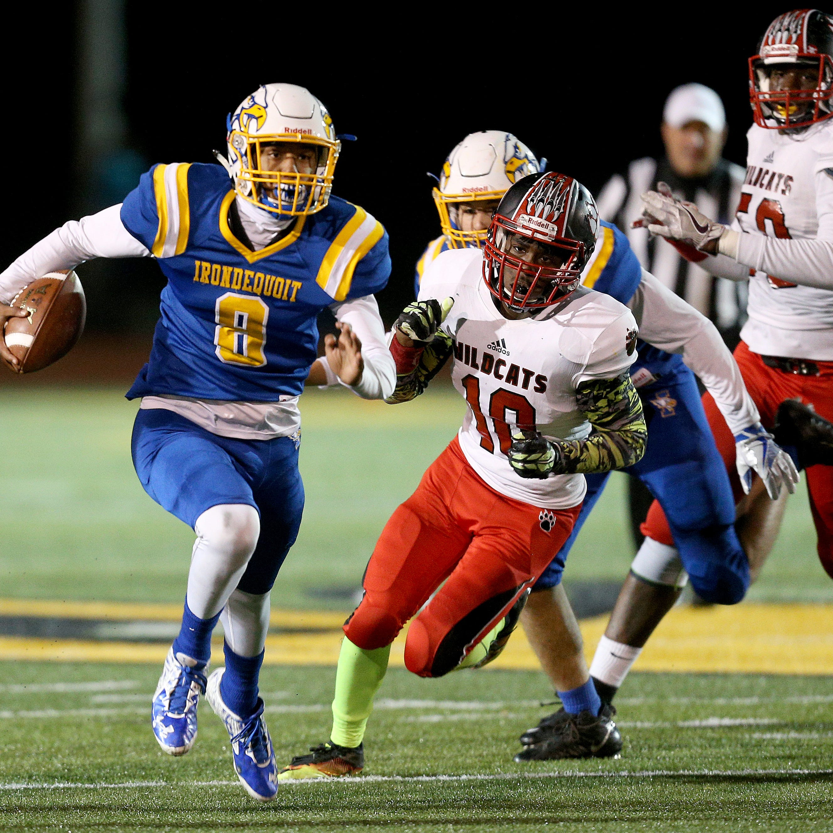 Irondequoit quarterback Freddy June Jr. carries the ball  in a 40-19 loss to Wilson in the 2017 Section V Class A final. June was named the 2017 All-Greater Rochester Player of the Year.