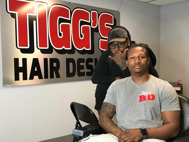 Marcus Wright, back, and Montel Williams, pose in Tigg's Hair Design on North Phillips Avenue in Sioux Falls.