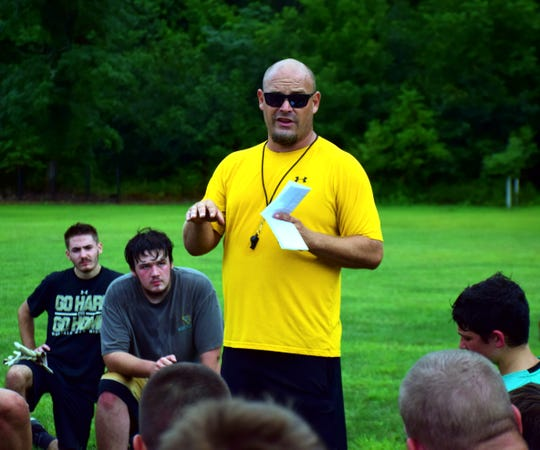 Buffalo Gap head football coach Andy Cline talks to his players during the team's first day of practice on Monday, July 30, 2018, at Buffalo Gap High School in Swoope, Va.