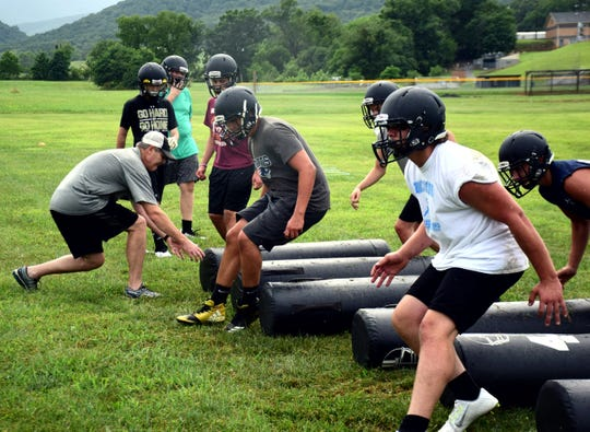 Buffalo Gap football players go through an agility drill during their first day of practice on Monday, July 30, 2018, at Buffalo Gap High School in Swoope, Va.