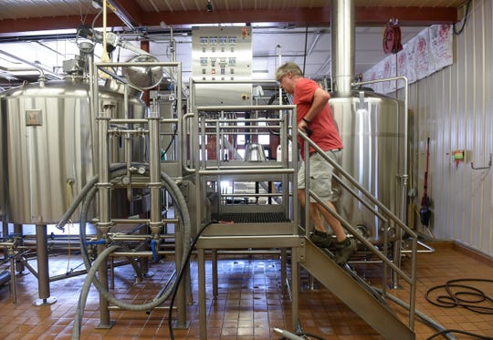 Beaver Island Brewing Company head brewer Chris Laumb brews a batch of the company's Uffda Ale Tuesday, July 31, in St. Cloud.