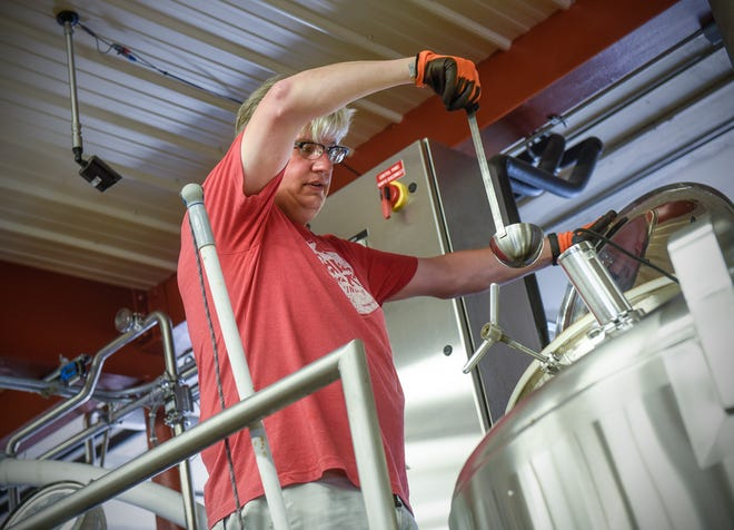 Beaver Island Brewing Company head brewer Chris Laumb draws a fresh sample of the company's Uffda Ale from the brew kettle Tuesday, July 31, in St. Cloud. The beer is brewed with lefse and lingonberries and will be available at the Minnesota State Fair.
