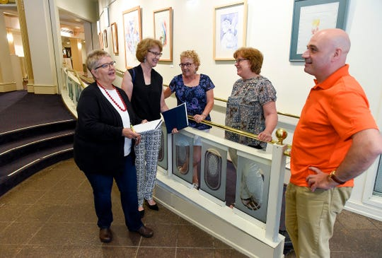 """St Cloud Neighborhood Coalition members Roxanne Ryan Layne, Jan Uberecken, Lori Long, Betsy Rakotz and Jason Neuerburg meet Tuesday, July 31, to plan the Aug. 14 """"There is No Place Like Home"""" event at the Paramount Center for the Arts."""