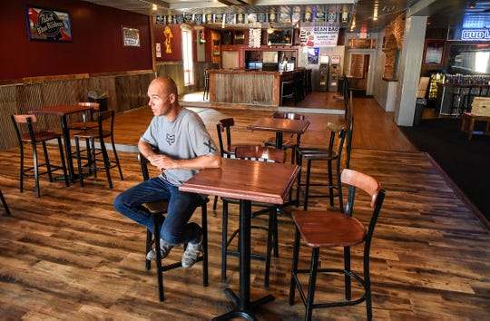 Andy Welsh, co-owner of the Press Bar, sits in the remodeled upstairs bar area Tuesday, July 31, along Fifth Avenue in St. Cloud.