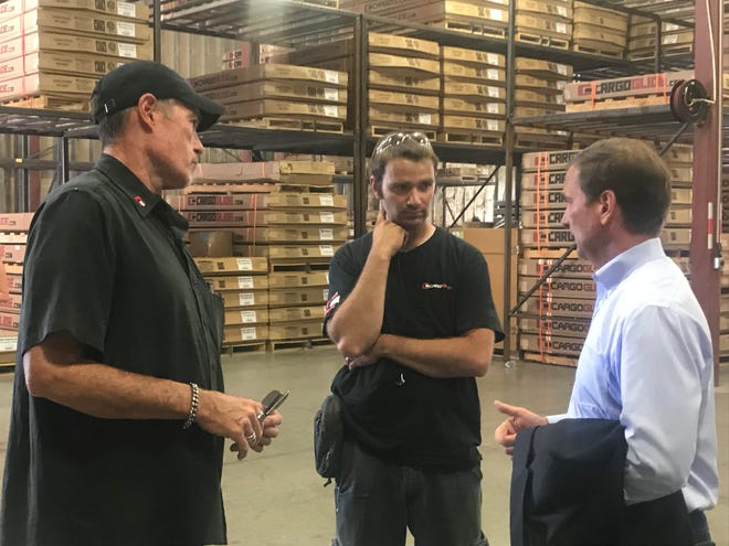 Chris Stewart, right, talks with employees at CargoGlide in St. George after a town hall-style meeting in the Fort Pierce Industrial Park on Monday, July 30, 2018.