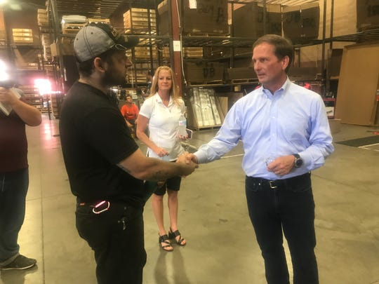 U.S. Rep. Chris Stewart, right, meets with employees at CargoGlide, a manufacturing company based in St. George, on Monday, July 30, 2018.