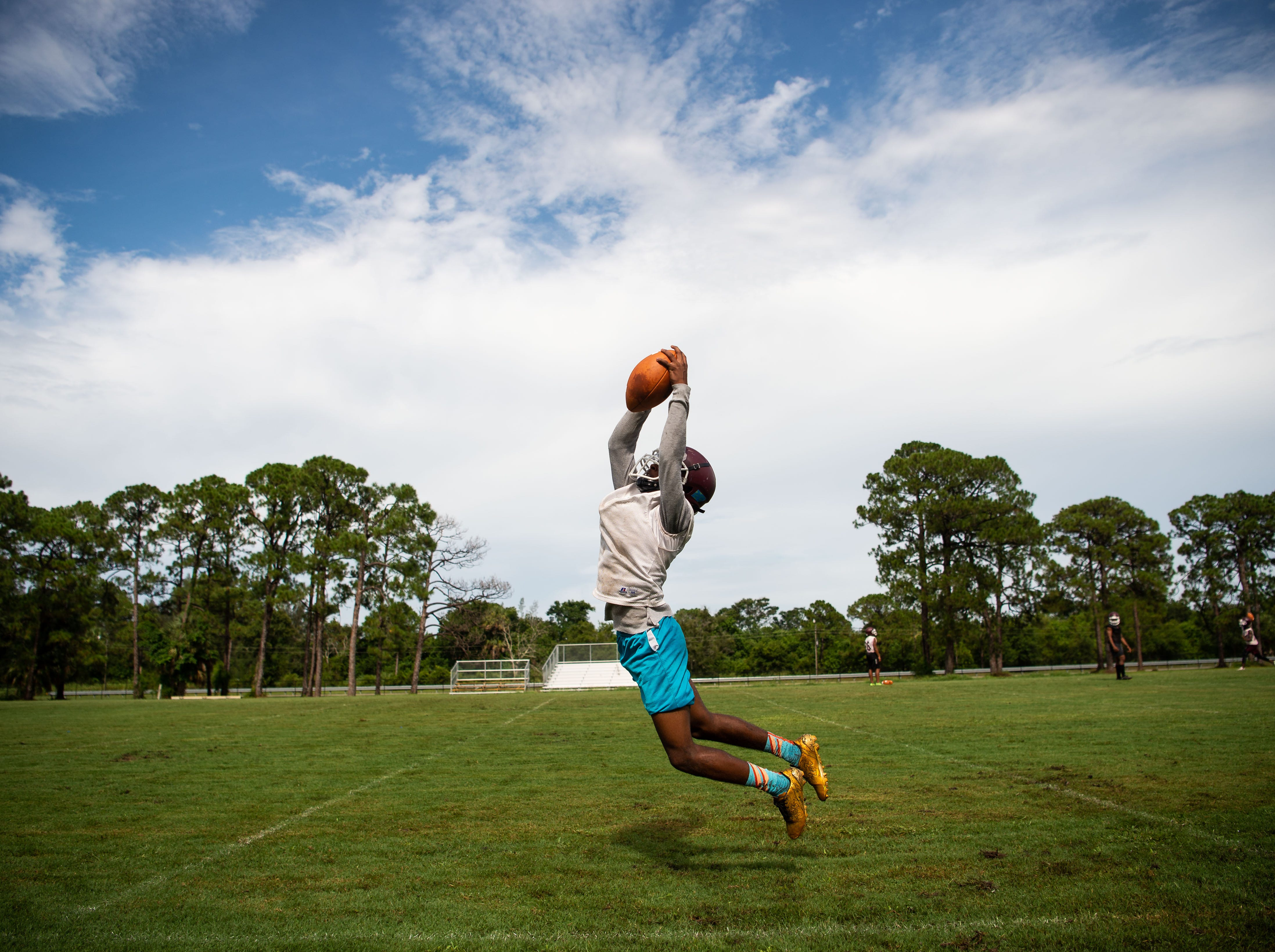 Fort Pierce Westwood receiver Cameron Webb catches a pass during a drill on the first day of football practice Monday, July 30, 2018, at Fort Pierce Westwood High School.