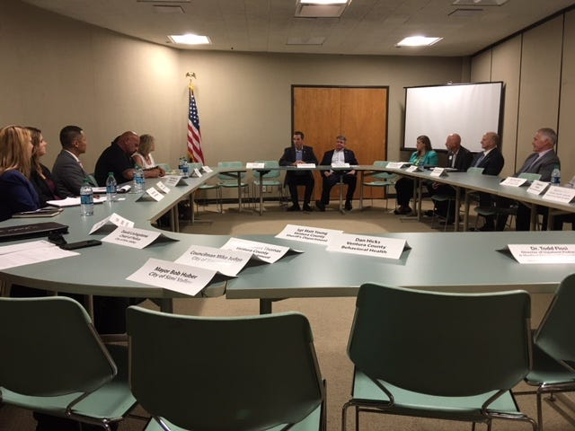 Congressmen Steve Knight, R-Palmdale, and Michael McCaul, R-Texas (rear), hosted a roundtable discussion Monday at Simi Valley City Hall to gather input from local leaders to help federal efforts to combat the nation's opioid epidemic and human trafficking.