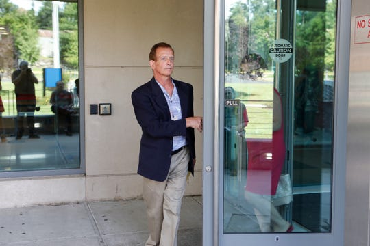 Joseph Lewin leaves the Rockland County Courthouse during his arraignment on multiple charges involving the sexual abuse of children he coached in tumbling and gymnastics on July 31, 2018.