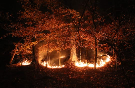 A large brush fire burns on Clausland Mountain in Orangeburg Nov. 15, 2013. Firefighters were stopping the flames as they moved toward houses on Greenbush Rd.