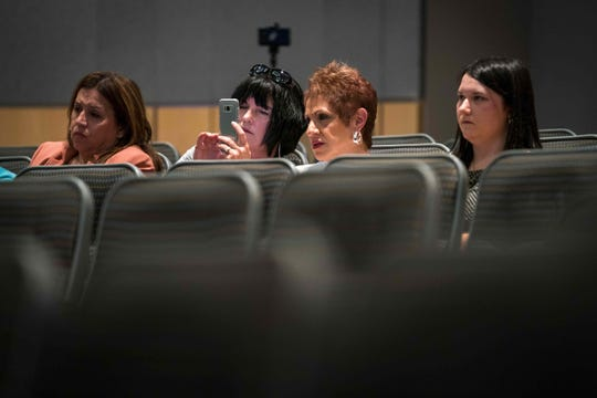 Attendees watch on July 30 as candidates Kathleen Ann Davies, Kathy K. McGuiness, and Dennis E. Williams debate at the Kent Count Administration Building in Dover.