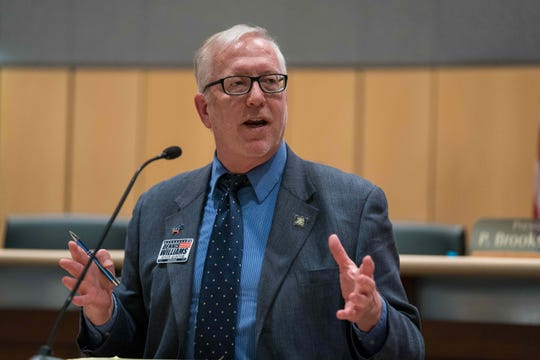 Dennis E. Williams, one of three Democratic candidates for state auditor, answers questions at a debate in Dover.