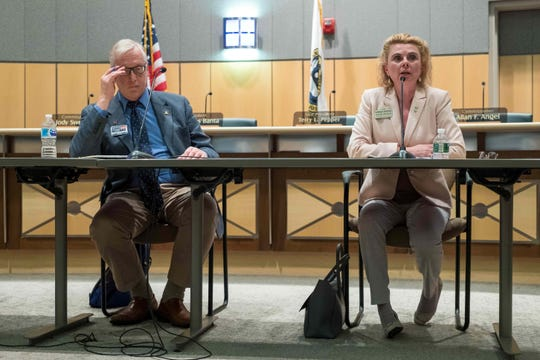 Candidates Kathleen Ann Davies (right), Kathy K. McGuiness, and Dennis E. Williams (left) on July 30 debate during a forum at the Kent Count Administration Building in Dover.