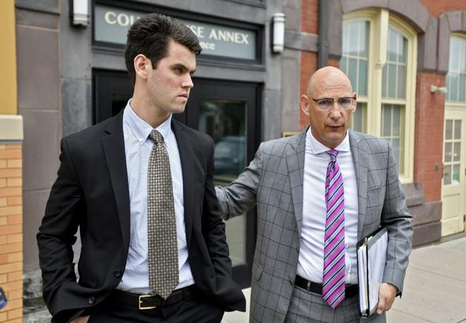 In this June 13, 2018, file photo, Ryan Burke (left), who was a fraternity brother at Penn State University's shuttered Beta Theta Pi chapter, walks with his attorney Philip Masorti outside the Centre County Courthouse Annex on the day Burke pleaded guilty to four counts of hazing and five alcohol-related offenses related to the death of 19-year-old fraternity pledge Timothy Piazza, of Lebanon, N.J.